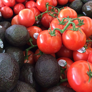 Fresh produce selection of tomatoes and avocados